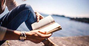 reading book on a beach