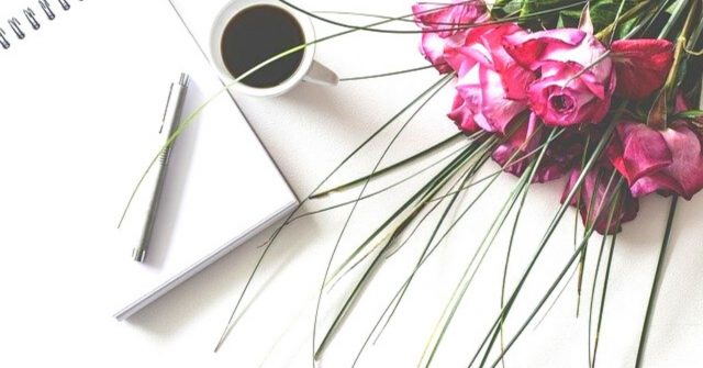 pink flowers and notebook
