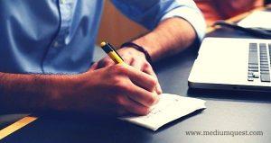 Men writing notes