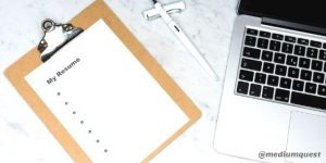 Printed white paper beside laptop